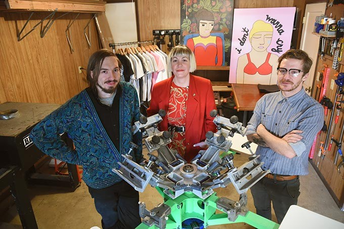 From left, Daniel Helm, Melissa Gray, and Tate James at Cheap Rent tee shirt print shop, located in an inner OKC garage.  mh