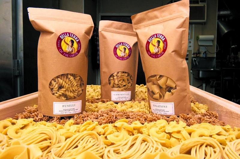 Chris Becker prepares Della Terra fresh pasta in a kitchen at Urban Agrarian with his own pasta machine. Photo/Shannon Cornman - SHANNON CORNMAN