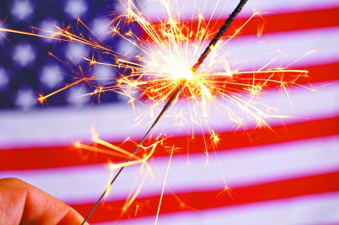 sparkler and usa flag showing 4th of july - BIGSTOCK