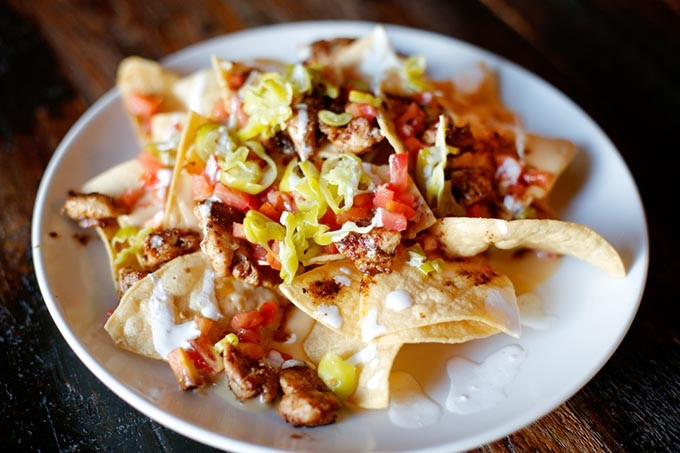 Chicken nachos at Oak & Ore in Oklahoma City, Tuesday, Sept. 22, 2015. - GARETT FISBECK