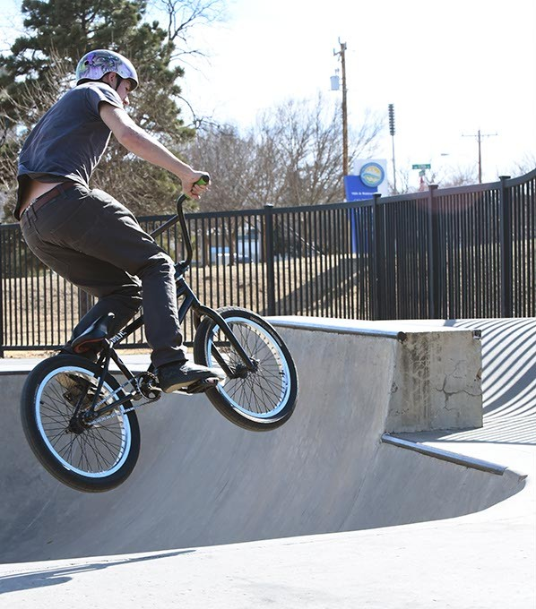18 year old Brandon Michell wears his helmet when he goes for a fly on his bike at the Mat Hoffman Action Sports Park in Oklahoma City, 2-17-16. - MARK HANCOCK
