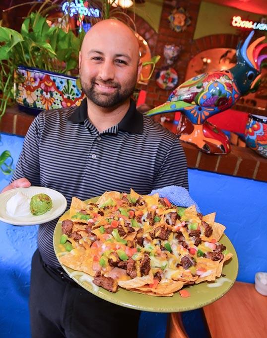 Abel Delpera with the El Mexicano Nachos at San Marcos Mexican Restaurant, 2301 SW 59th Street, 9-8-15. - MARK HANCOCK