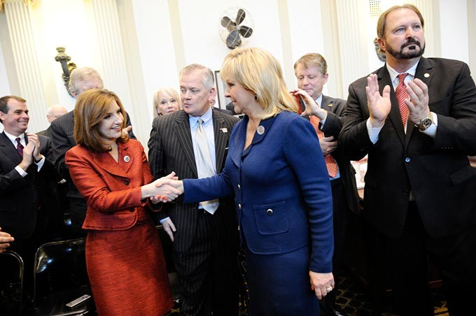 Mary Fallin shakes hands with State Superintendent Joy Hofmeister before her State of the State address at the Oklahoma State Capitol in Oklahoma City, Monday, Feb. 2, 2015. - GARETT FISBECK