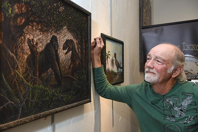 """Tony Trammell with his work """"King Kong"""", on the wall at Planet Dorshak gallery on The Paseo.  mh"""