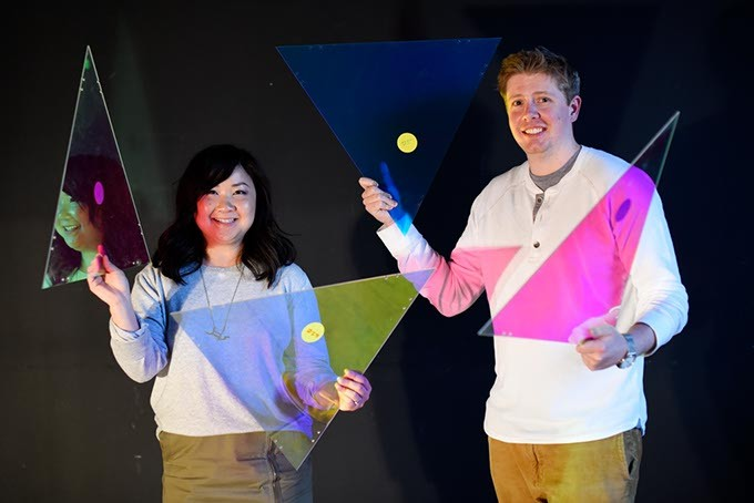 Anh Weber and Adam Edge with dichroic film on acrylic, used to create a faceted fabric, at HSE Architects. (Garett Fisbeck)
