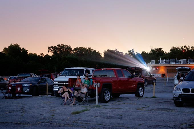Patrons relax in the glow of high-definition film projection at Winchester Drive-In. (Garett Fisbeck)