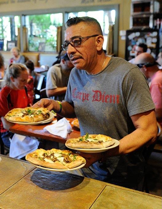 Juan Adame at The Wedge Pizzeria in Oklahoma City, Wednesday, July 1, 2015. - GARETT FISBECK