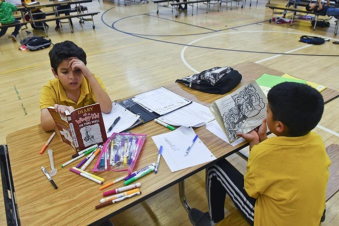 Two boys at Santa Fe South elementary, an OKC Charter School, read books during a Boys and Girls Club After school program, 11-9-15. - MARK HANCOCK