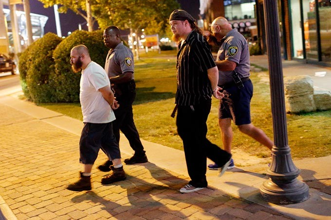 """Members of the Satanic church Dakhma of Angra Mainyu are arrested after starting a fight following a showing of the film """"The Real Enemy"""" during the DeadCENTER Film Festival at Harkins Theatre in Oklahoma City, Thursday, June 11, 2015. - GARETT FISBECK"""