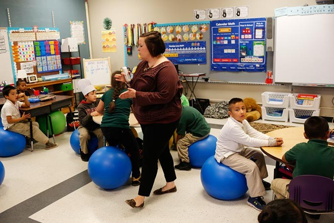 Ms. Killy Higham teaches a lesson to her first grade class at Shidler Elementary in Oklahoma City, Tuesday, Nov. 10, 2015. - GARETT FISBECK