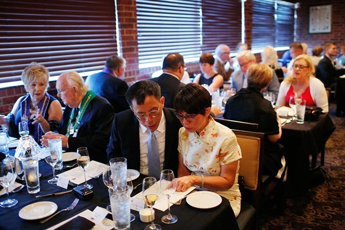 Members wait to dine during a meeting of The Chaine des Rotisseurs at Opus Prime Steakhouse in Oklahoma City, Saturday, July 25, 2015. - GARETT FISBECK