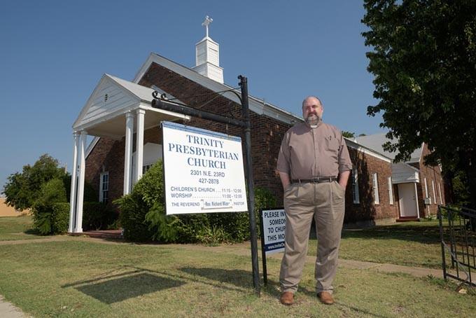 Rev. Richard Mize poses for a photo at Trinity Presbyterian Church. (Garett Fisbeck)