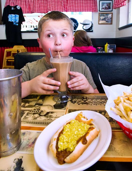 Bradynn Hall slurps down a peanut butter chocolate shake at Sid's Diner in El Reno.Photo/Shannon Cornman - SHANNON CORNMAN