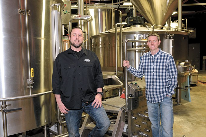 Dave Monks and Jerod Millirons? at Iron Monk Brewing in Stillwater. (Garett Fisbeck)