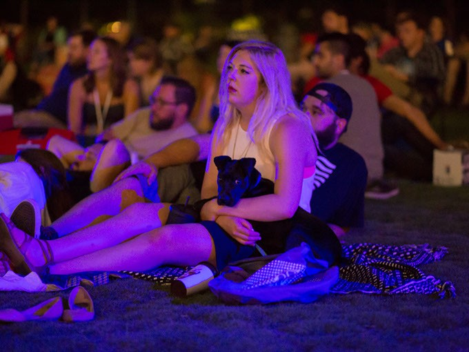 People sit on the lawn of the Myriad Botanical Gardens for a showing of ET in Oklahoma City, Friday, June 10, 2016. - EMMY VERDIN