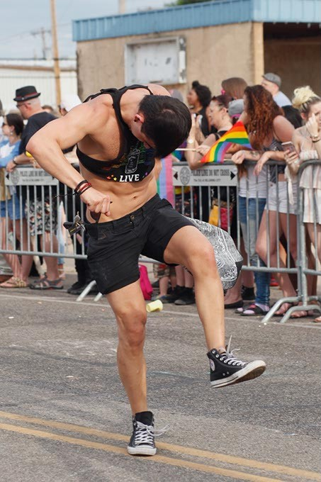 A man dances doown 39th St. during the Pride Parade on Sunday, June 25, 2017. (Cara Johnson).