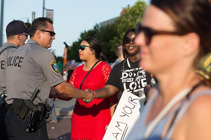 Black Lives Matter protestors shake the hands of police officers on Sunday, July 10, 2016 in Oklahoma City. - EMMY VERDIN