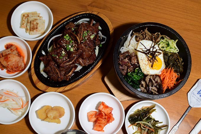 from left Galbi and bibimbab surrounded by banchan | Photo Mark Hancock / for Gazette