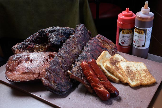 Ribs, brisket, hot links, and bologna, at Leo's BBQ, Monday, Dec. 5, 2016. - GARETT FISBECK