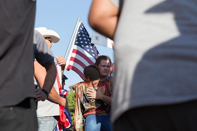 Black Lives Matter protestor gives a hug to a Conferate flag carrying protestors on Sunday, July 10, 2016 in Oklahoma City. - EMMY VERDIN