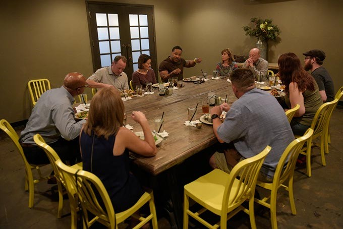 A group talks during at reconciliation dinner at Iron Star Barbecue, Tuesday, Aug. 2, 2016. - GARETT FISBECK