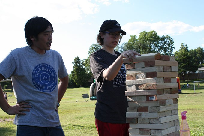 From left Matt Fong and Lacy Kelly set up a Jenga set during the recent Classen Ten Penn Community Festival at McKinley Park. | Photo Laura Eastes
