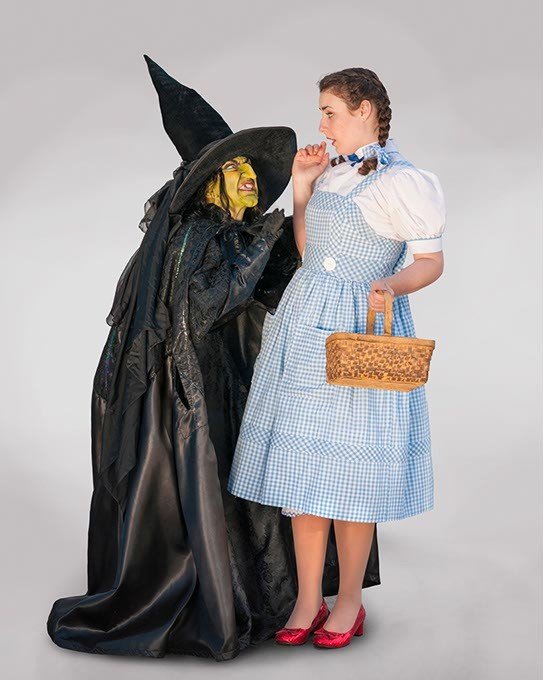 Renee Anderson as the Wicked Witch of the West and Arden Walker as Dorothy. Photo by KO Rinearson - KO RINEARSON