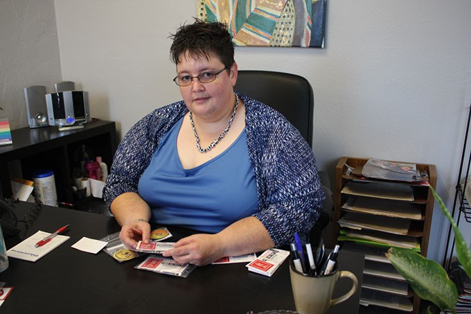 Jenny Archer packs condom kits to be distributed during OKC Pride Week. | Photo Laura Eastes