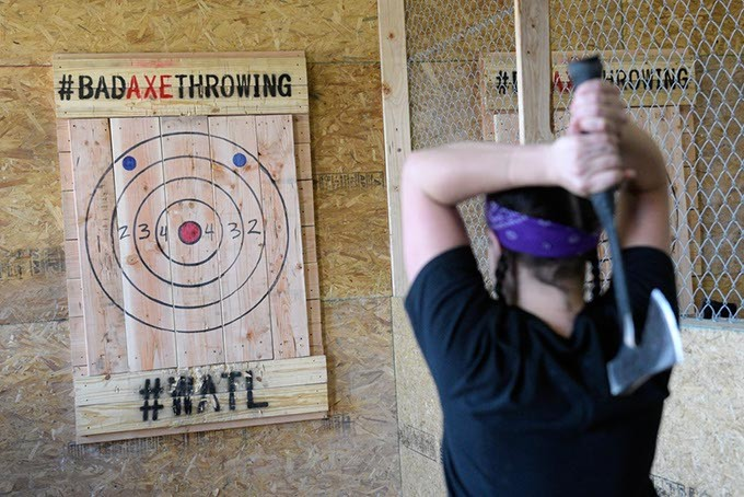 Leslie Hensley prepares to throw an ax at Bad Axe Throwing in Oklahoma City's Farmers Market District. (Garett Fisbeck)