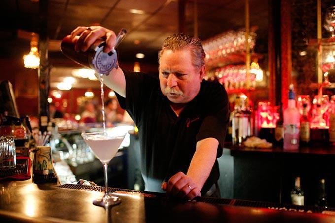 Steve White makes a classic martini at Junior's, Tuesday, June 28, 2016. - GARETT FISBECK