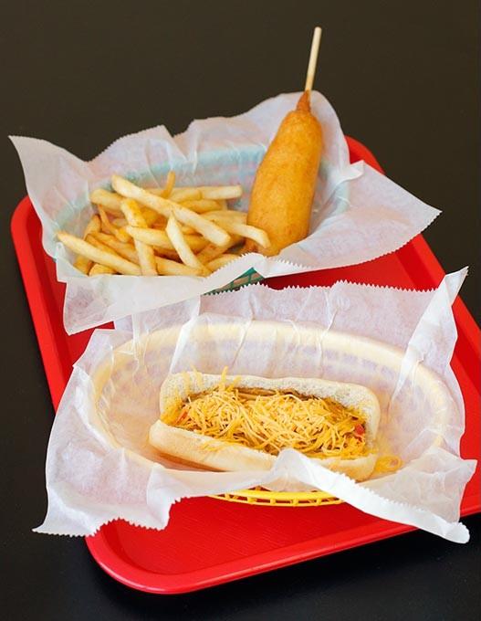 Chili cheese dog, corn dog and fries, at Coneys-N-More, Thursday, June 29, 2017. - GARETT FISBECK