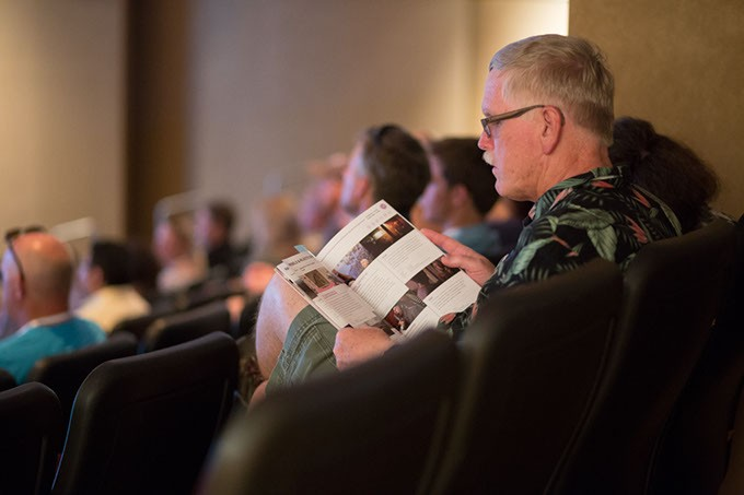 """Larry Hopper reads the Dead Center Film Schedule at the Museum of Art Theatre in Oklahoma City, Saturday, June 11, 2016.  Hopper was in attendance for a showing of """"Tower"""". - EMMY VERDIN"""
