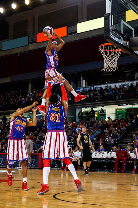 1de8196f2feb click to enlarge Rocket Pennington dunks a ball during a Globetrotters  game.