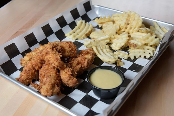 Chicken tenders with truffle fries at 1907 Burgers & Brews in Moore, Friday, Sept. 23, 2016. - GARETT FISBECK