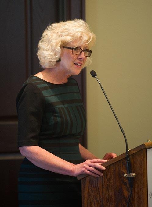Deborah Price speaks during a ReMerge graduation at the Oklahoma City Community Foundation, Thursday, June 30, 2016. - GARETT FISBECK