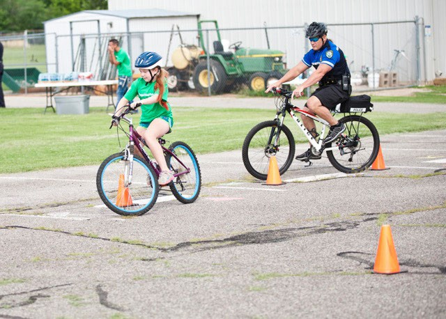 Children participate in a YMCA bicycle safety course. Y Without Walls, hosted by YMCA of Greater Oklahoma City, is June 5 in Automobile Alley. - PROVIDED