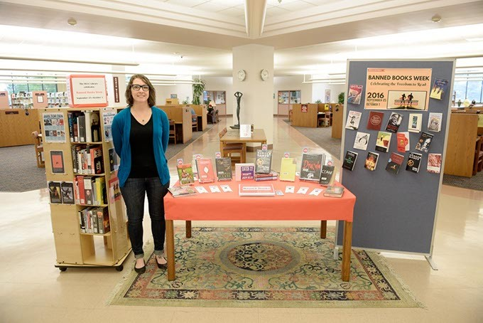 Librarian Tricia Sweany stands by a banned books display at Kieth Leftwich Memorial Library at Oklahoma City Community College. (Garett Fisbeck)