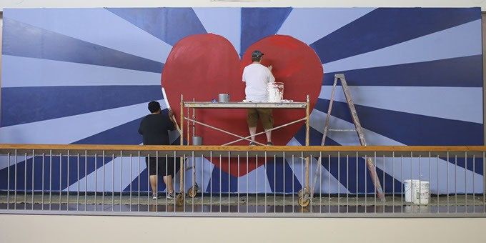 Alexander Tomlin, right, and Colton Fields work on painting the mural at Plaza Mayor on Wednesday, May 24, 2017. (Cara Johnson).