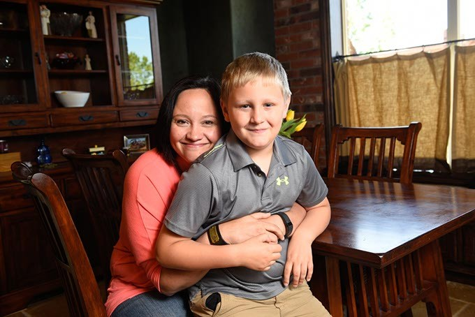 Wendy Elliott and her song, Adam, 9, pose for a photo at their home in Mustang, Wednesday, May 4, 2016. - GARETT FISBECK