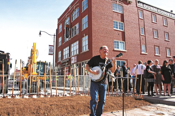 Johnny Baier strums the banjo as the crowd gathers for the groundbreaking of the MAPS 3 modern streetcar in Bricktown. | Photo Laura Eastes
