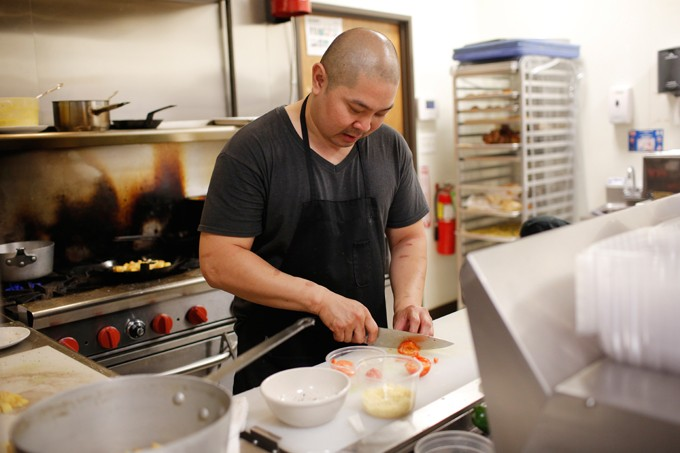 Chef Vuong Nguyen in the kitchen at Bonjour in Oklahoma City, Wednesday, July 29, 2015. - GARETT FISBECK