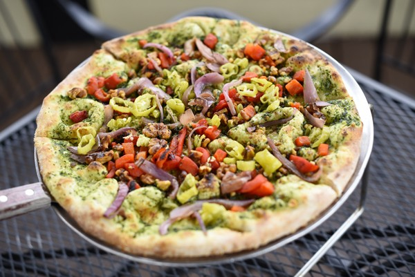 The Wedge Pizzeria's The Brandon, with pesto, roasted red onion and red bell pepper, pepperoncinis and spiced walnuts   Photo Garett Fisbeck