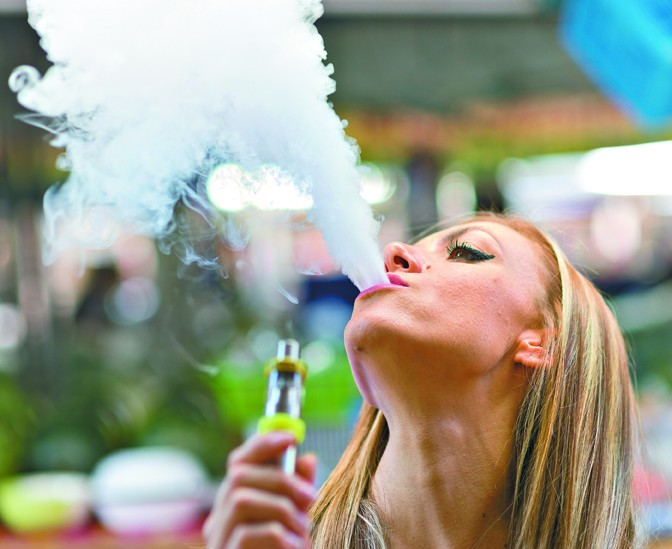 close up of a young woman with hookah - BIGSTOCK
