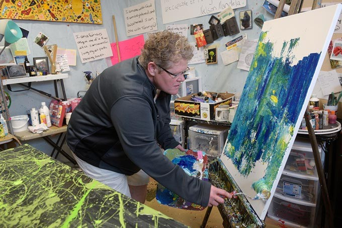 Tammy Conover works on a painting at her studio, Monday, Feb. 27, 2017. - GARETT FISBECK