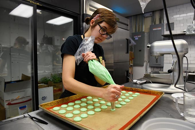 ?Kaci Messerly pipes macarons at Belle Kitchen, Tuesday, May 10, 2016. - GARETT FISBECK