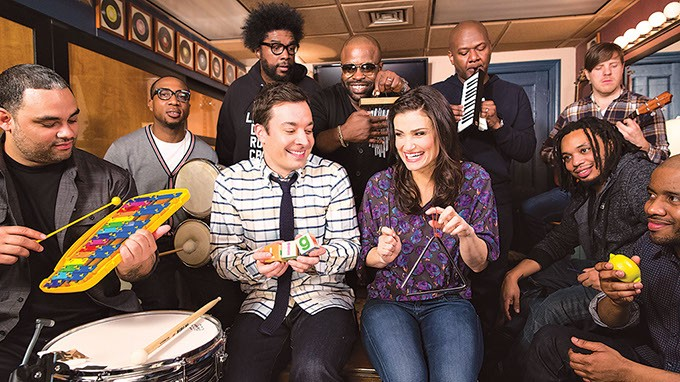 "The Roots perform ""Let It Go"" using only classroom instruments with (center) Jimmy Fallon and Idina Menzel on The Tonight Show Starring Jimmy Fallon. (Photo YouTube / provided)"