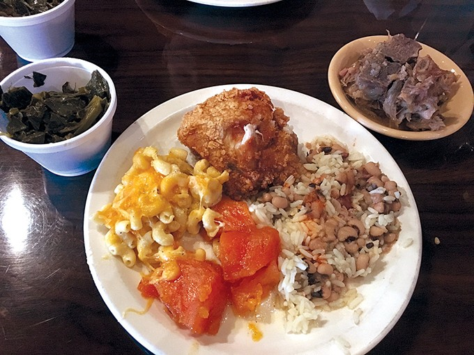 A pass through the buffet includes macaroni and cheese, candied yams, black-eyed peas with rice, fried chicken, neck bones and collard greens. - PHOTO BY JACOB THREADGILL