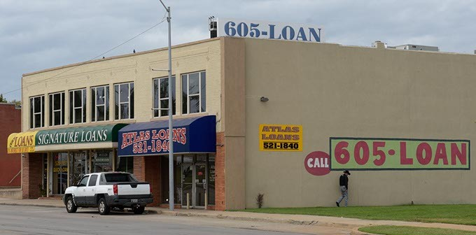 Quick Loans, Signature Loans and Atlas Loans operate along NW 23rd Street near Broadway Exchange. (Garett Fisbeck)