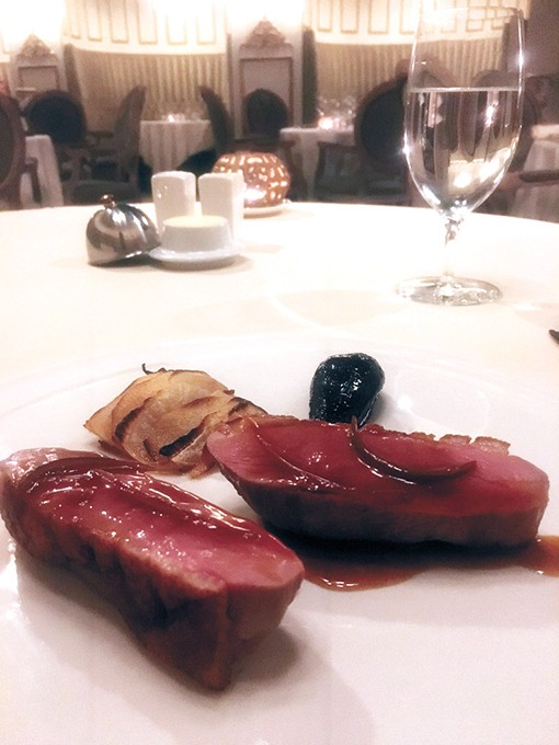 Seared duck in spiced honey - and lime sauce with red wine poached pear and turnip-celery gratin. - JACOB THREADGILL