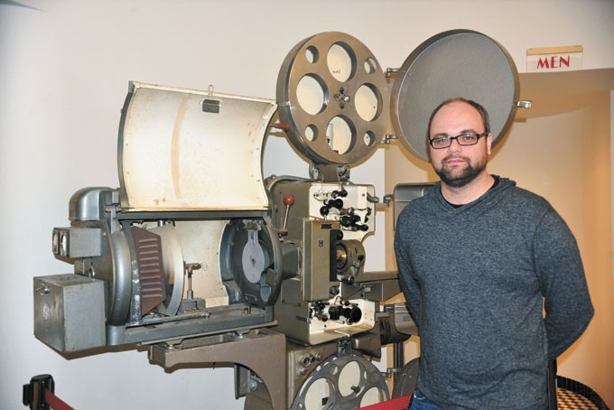 Tower Theatre operator Stephen Tyler shows the one of theater's original projector. | Photo Jacob Threadgill